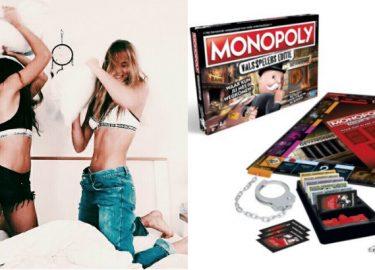 Kussengevecht tussen twee meisjes op bed en het Monopoly valsspelers editie spel